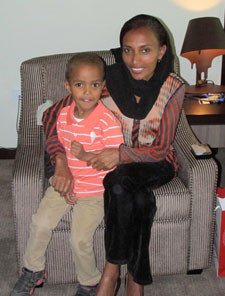 Berhane Tesfaye and her son, Fiteh, try to visit Woubshet Taye every week. (CPJ)