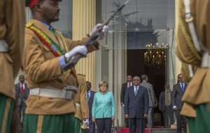 German Chancellor Angela Merkel, center-left, and Ethiopia's Prime Minister Hailemariam Desalegn, center-right, inspect the honor guard at the national palace in Addis Ababa, Ethiopia Tuesday, Oct. 11, 2016. Merkel is visiting Ethiopia, where her meeting with Prime Minister Hailemariam Desalegn is expected to focus on the country's newly declared state of emergency, after months of protests demanding wider freedoms, and other issues including migration. (Mulugeta Ayene/Associated Press)